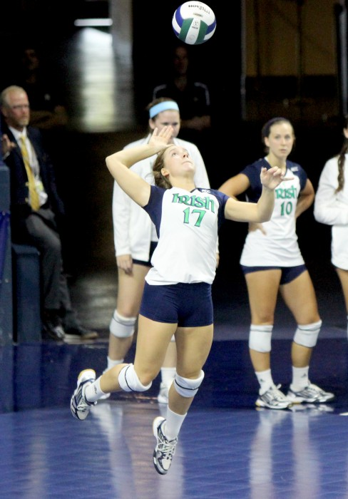 Irish senior libero Erin Klosterman goes up for a serve against Polish club team Dabrowa in an exhibition match Sept. 8, 2013 at Purcell Pavilion.