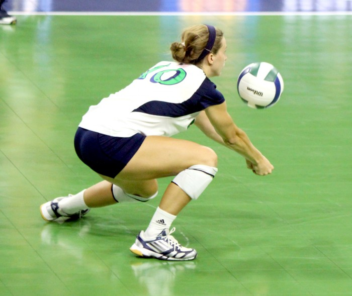 Notre Dame senior libero Kathleen Severyn digs a ball against Polish club team Dabrowa in an exhibition match on Sept. 8, 2013. Severyn and the Irish host the Shamrock Invitational this weekend at the Purcell Pavilion.