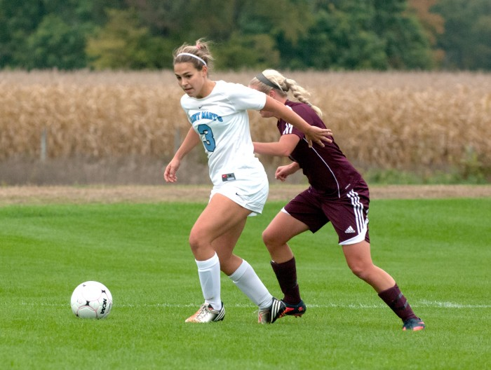 Saint Mary's junior defender Lindsay Rzepecki controls the ball during a game against Alma on Oct. 16.
