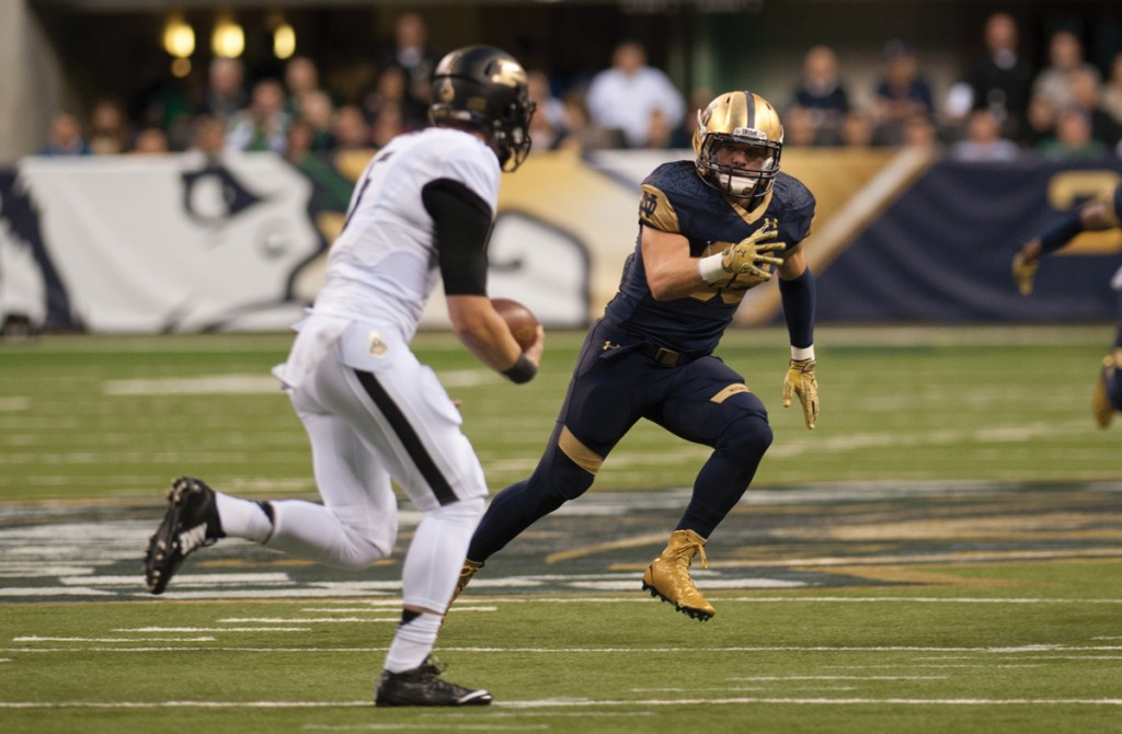 Irish senior linebacker Joe Schmidt aims to track down Purdue sophomore quarterback Danny Etling.