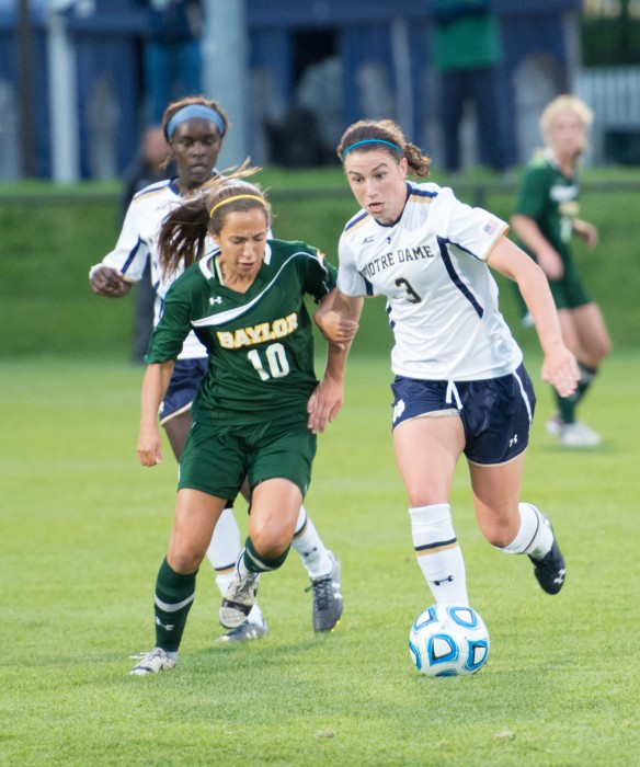 Irish sophomore midfielder Morgan Andrews battles with a defender for the ball during Notre Dame's 1-0 victory over Baylor on Friday at Alumni Stadium.