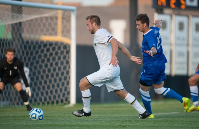 Irish senior forward Vince Cicciarelli keeps a defender at bay during Notre Dame's 1-0 loss to Kentucky on Sept. 8. Cicciarelli had two shots against Syracuse on Saturday.