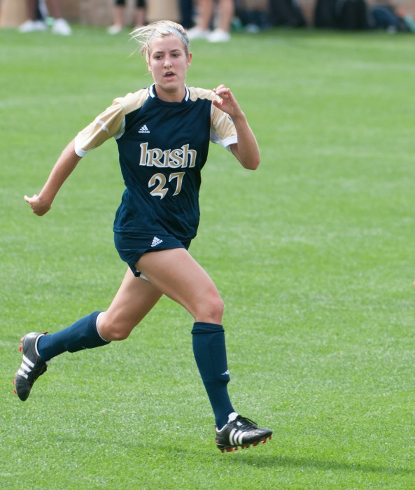 Irish sophomore forward Kaleigh Olmsted sprints up the pitch against UCLA on Sept. 1, 2013 at Alumni Stadium. Olmsted registered her first point this season Sunday with an assist against Toledo.