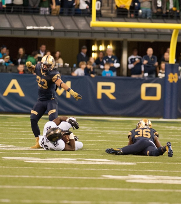 Irish freshman safety Drue Tranquill celebrates a tackle during Notre Dame's win against Purdue on Saturday at Lucas Oil Stadium.