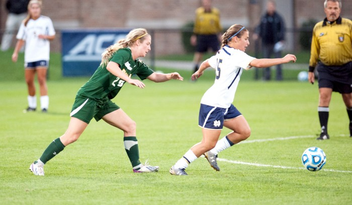 Irish freshman defender Sabrina Flores keeps an attacker away from the ball during Notre Dame's 1-0 victory over Baylor on Sept. 12 at Alumni Stadium.