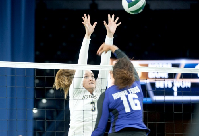 Irish freshman middle blocker Sam Fry leaps up for a block in Notre Dame's 3-1 loss to TCU on Sept. 19 at Purcell Pavilion.
