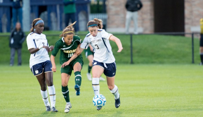 Irish sophomore midfielder Morgan Andrews tries to keep the ball away from a Baylor defender in a 1-0 home win on Sept. 12.