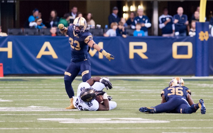 Irish freshman safety Drue Tranquill, 23, backs up sophomore cornerback Cole Luke on a tackle during Notre Dame's 30-14 win over Purdue on Sept. 13 at Lucas Oil Stadium.