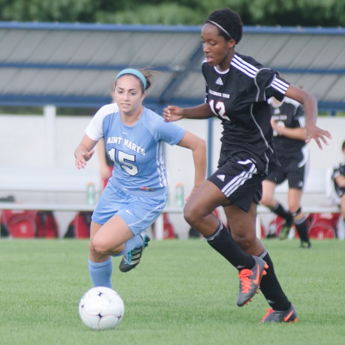 Saint Mary's senior midfielder tracks down an Illinois Tech player during the Belles' 4-1 win on Sept. 2, 2013.
