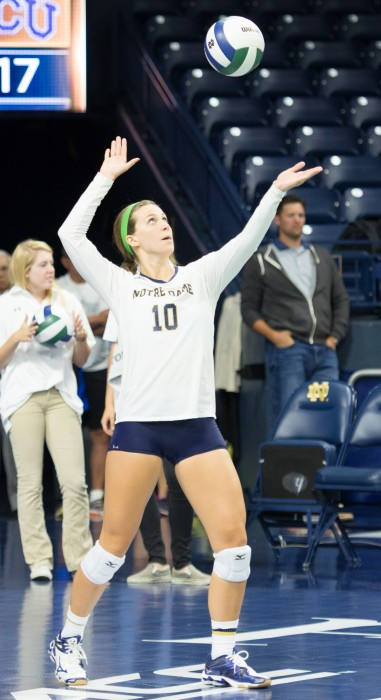 Irish senior libero Kathleen Severyn launches a serve during a 3-1 loss to TCU on Sept. 12 at Purcell       Pavilion. Severyn collected six digs and two assists over the weekend against Miami and Florida State.