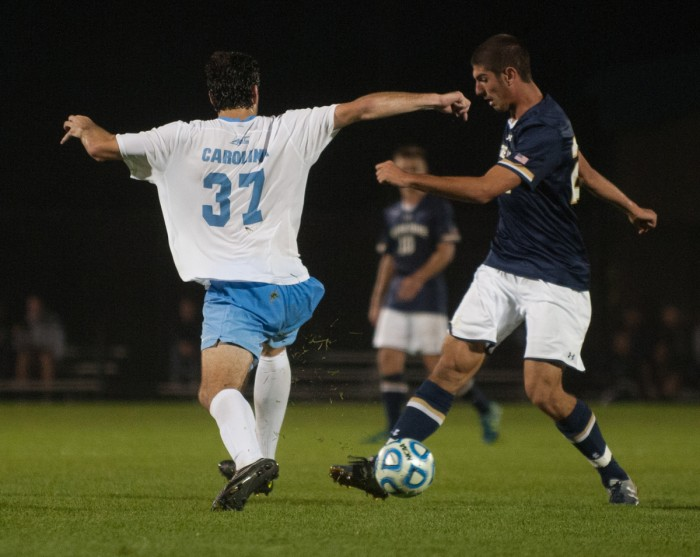 Irish freshman forward Jeffery Farina shields the ball as a North Carolina defender attempts to take it away during Notre Dame's 2-0 victory over the Tar Heels on Friday at Alumni Stadium.
