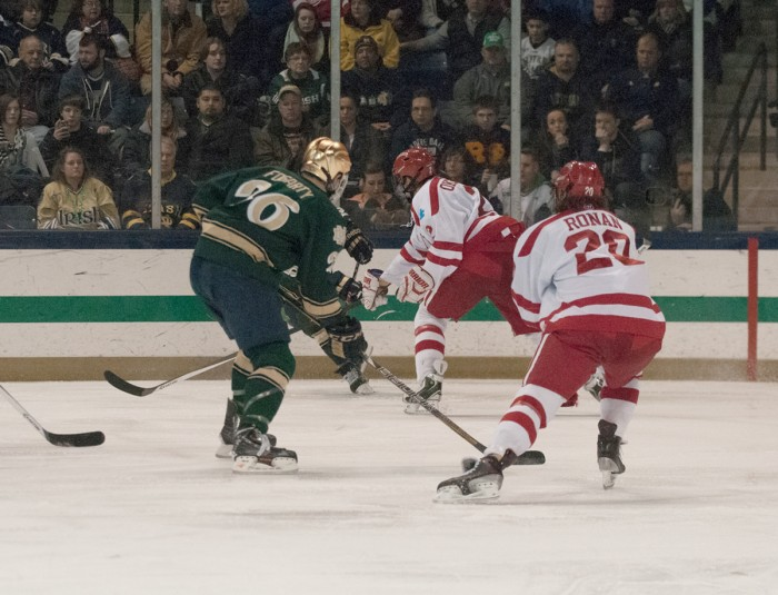 Irish junior captain Steven Fogarty surveys the offensive zone against Boston University on Feb. 22 at Compton Family Ice Arena.