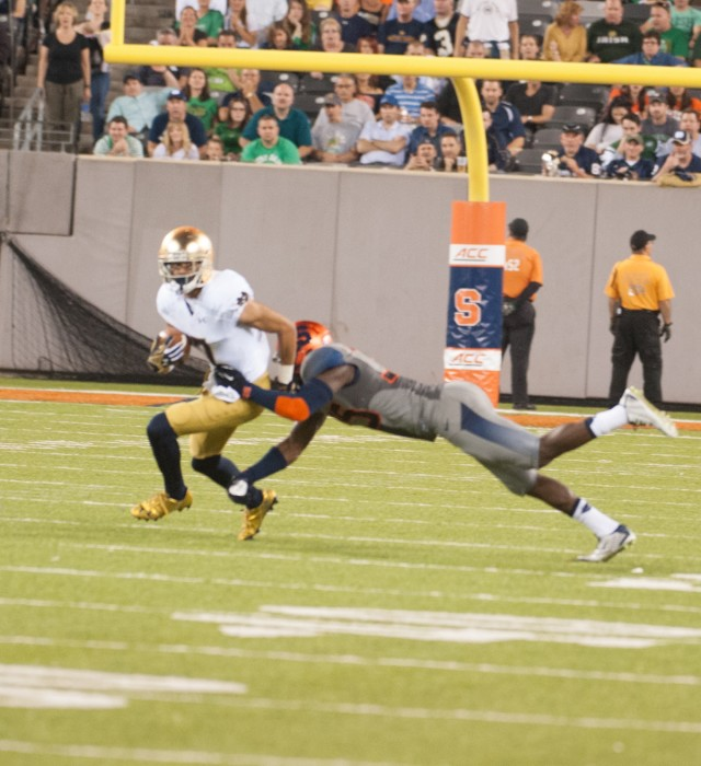 Irish sophomore Will Fuller breaks a tackle Saturday against     Syracuse at MetLife Stadium during Notre Dame's 31-15 win.