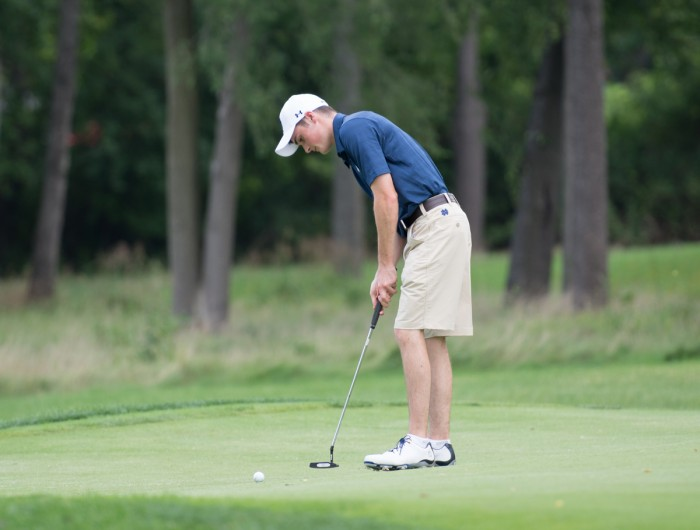 Irish sophomore Liam Cox lines up a putt during the Notre Dame Kickoff Challenge on Aug. 31 at Warren Golf Course.