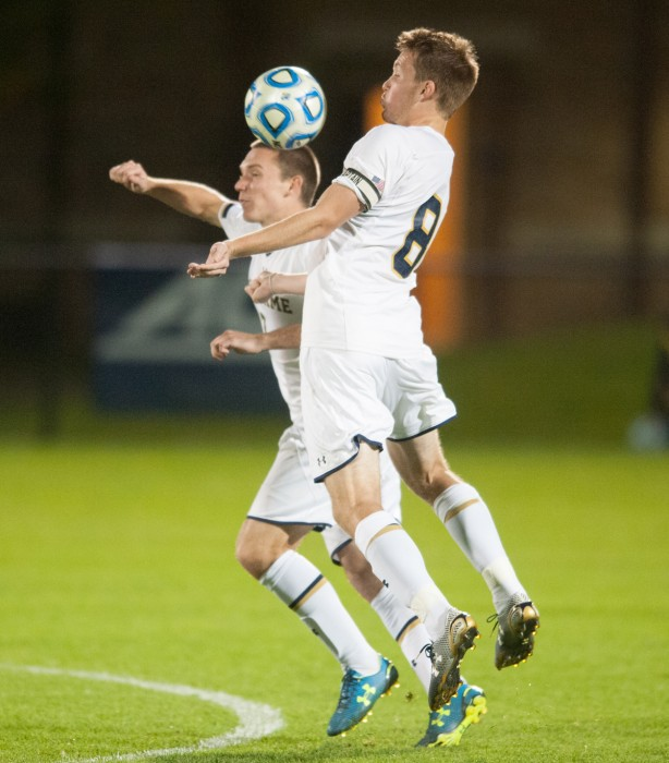 Irish senior midfielder and captain Nick Besler, right, goes up for a ball in the air during Notre Dame's 1-0 win over VCU on Tuesday.