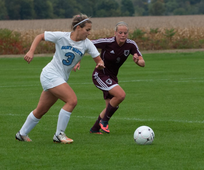 Belles junior defender Lindsay Rzepecki dribbles past an opponent during a 1-0 home loss against Alma on Oct. 16.