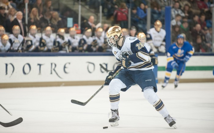 Irish junior center and captain Steven Fogarty receives the puck in Notre Dame's 4-2 victory against Lake Superior State on Jan. 18 at Compton Family Ice Arena. Fogarty begins his first season as Irish captain Sunday in the team's exhibition game against Waterloo.