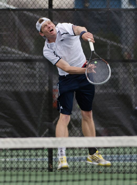 Irish junior Alex Lawson launches a serve during Notre Dame's match with Florida State on April 3 at Eck Tennis Pavilion.