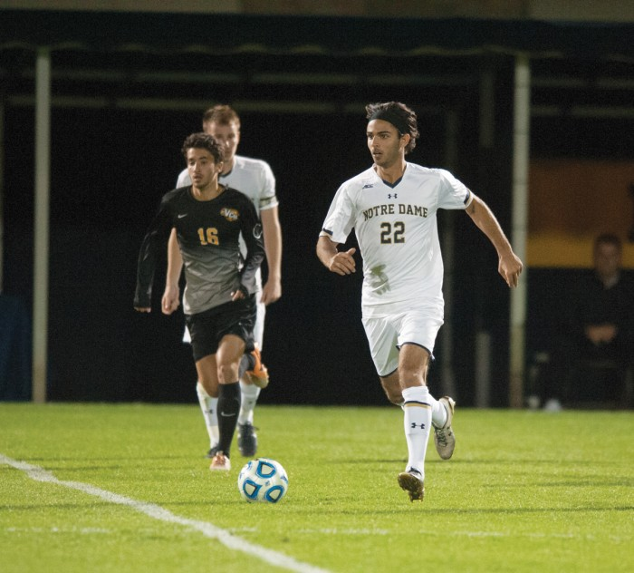 Irish senior defender Luke Mishu sprints to the ball during Notre Dame's 1-0 win against VCU on Tuesday at Alumni Stadium.