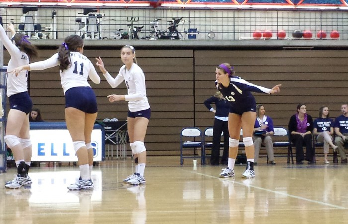 Sophomore Meaghan Gibbons (right) sets up her team in  preparation for a serve during  a 3-0 loss to Alma on Oct. 3.