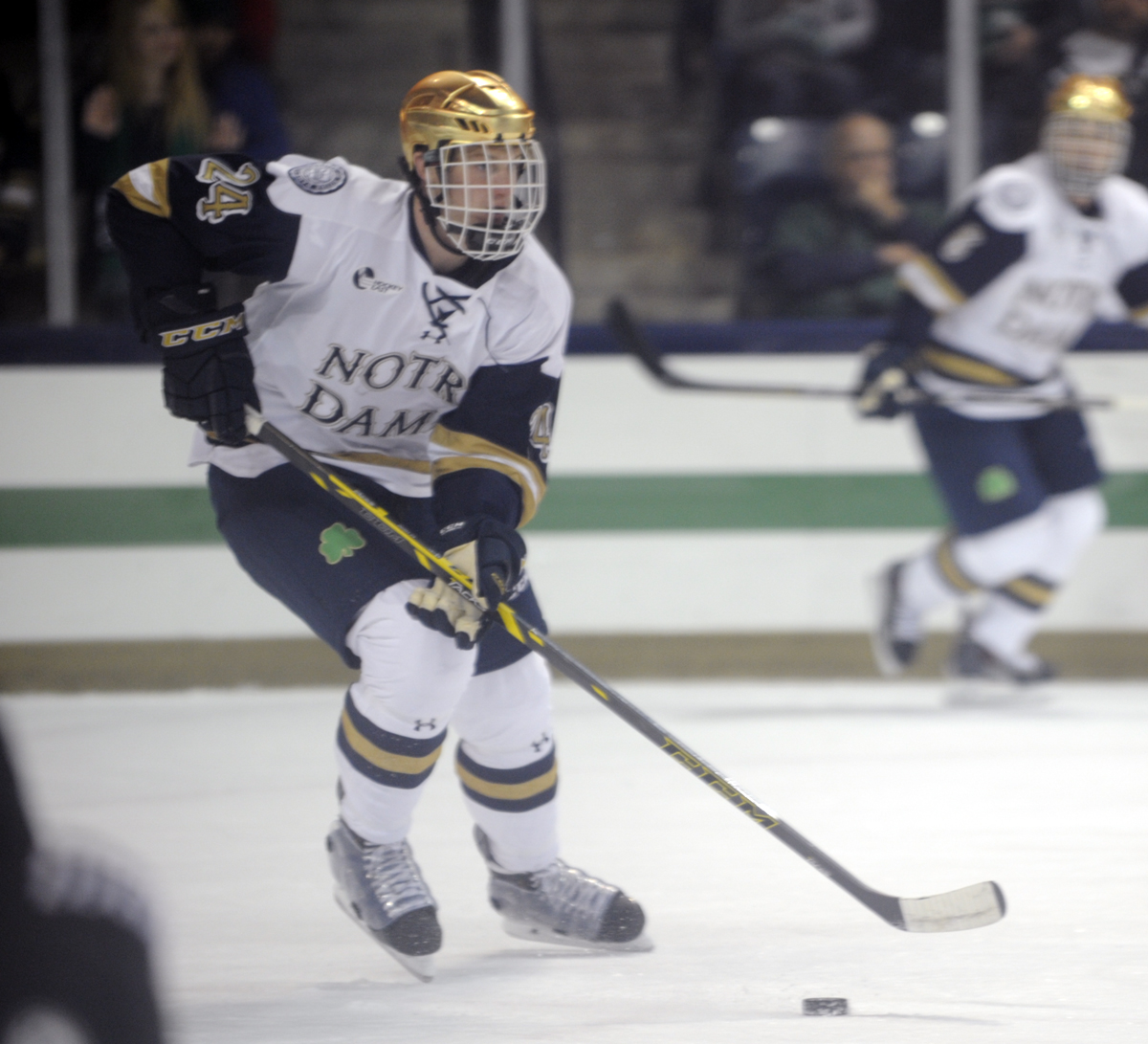 Irish freshman defenseman Luke Ripley looks for an opening during Notre Dame's exhibition game against Waterloo on Sunday.