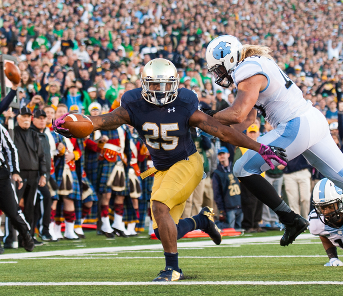 Irish sophomore running back Tarean Folston extends for one of his three touchdowns during Notre Dame's 50-43 victory over North Carolina on Saturday at Notre Dame Stadium.