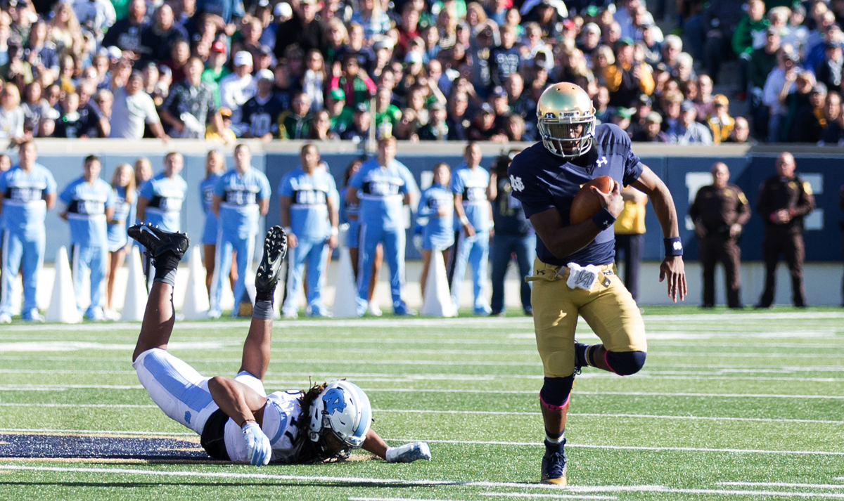 Irish senior quarterback Everett Golson scampers downfield during Notre Dame's 50-43 win over North Carolina on Saturday at Notre Dame Stadium.