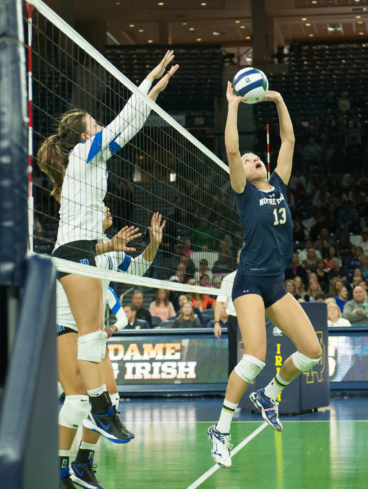 Irish junior setter Hanna Muzzonigro sets the ball to a teammate in Notre Dame's 3-1 loss to Duke on Oct. 5 at Purcell Pavilion.