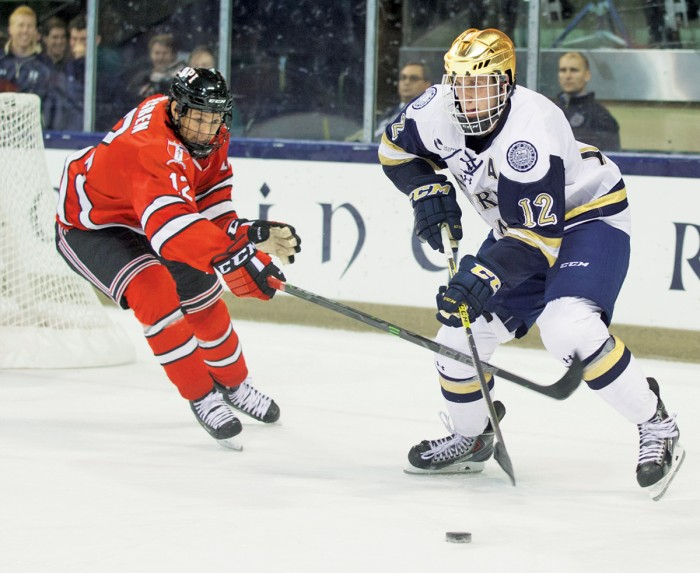 Irish junior left wing Sam Herr tries to sneak past a Rensselaer defender during Notre Dame's 3-2 loss to the Engineers on Friday.