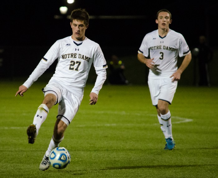 Irish junior midfielder Patrick Hodan dribbles down the field in Notre Dame's 3-2 win against Louisville on Friday in extra time