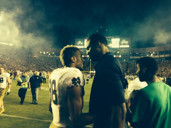 Irish sophomore receiver Corey Robinson and his father, former basketball great David Robinson, meet after Notre Dame's 31-27 loss to Florida State on Saturday night in Tallahassee, Florida.
