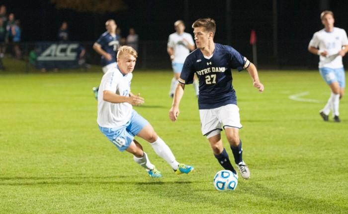 Irish junior midfielder Patrick Hodan dribbles down the field in Notre Dame's 2-0 win against North Carolina on Sept. 26.
