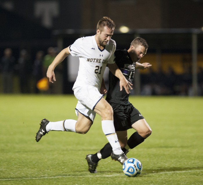 Irish senior forward Vince Cicciarelli battles for possession of the ball with a defender during Notre Dame's 1-0 victory over Northwestern on Oct. 14, at Alumni Stadium.