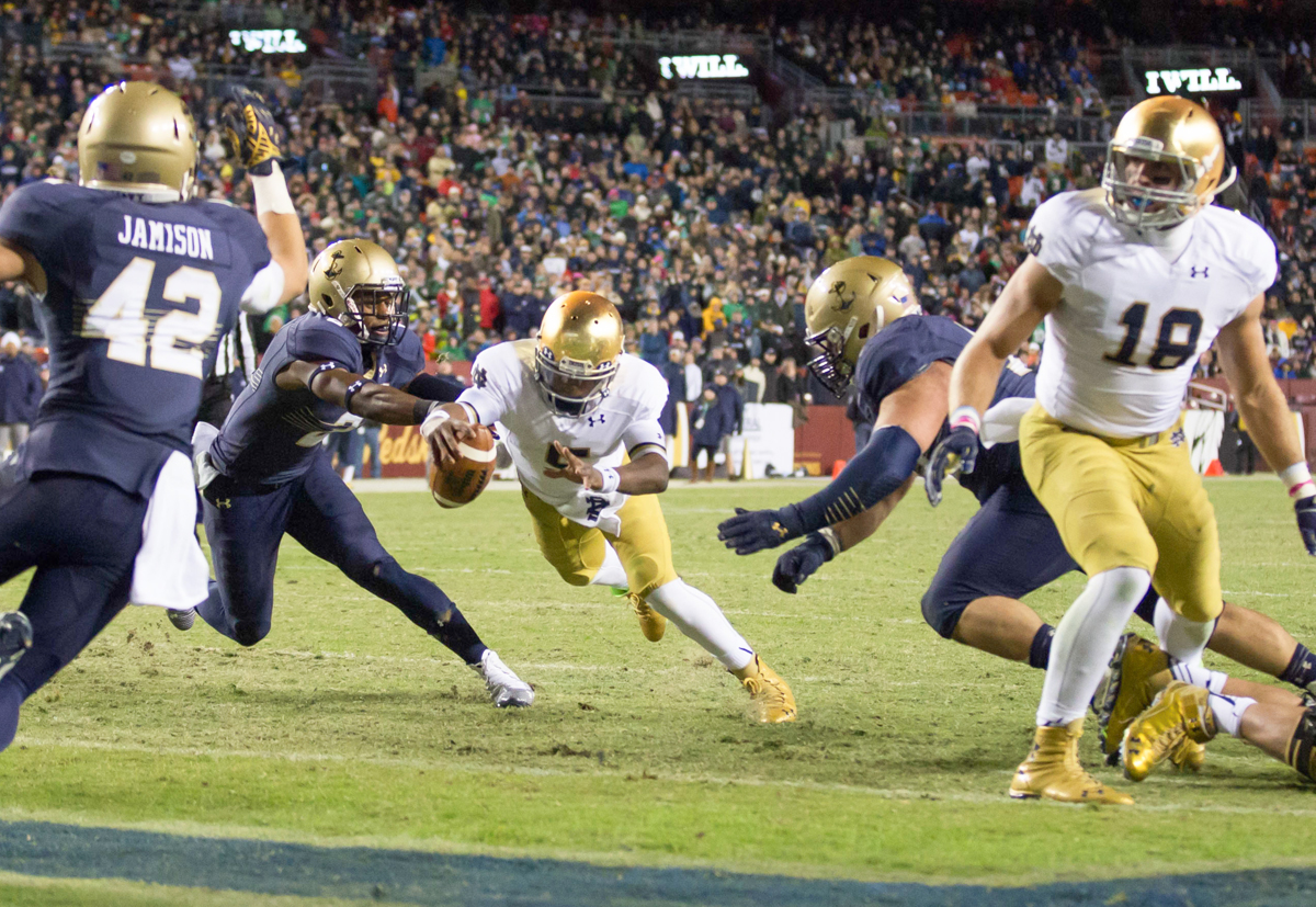 Irish senior quarterback Everett Golson dives forward for a fourth-quarter rushing touchdown to put Notre Dame back ahead en route to its 49-39 win over Navy on Saturday in Landover, Maryland.
