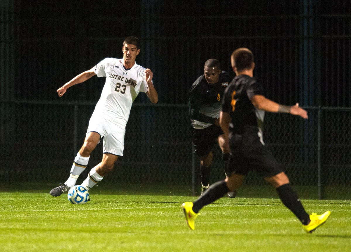 Irish freshman forward Jeffrey Farina protects the ball from a VCU defender Sept. 30 at Alumni Stadium. Notre Dame won the match 1-0 in double overtime. Farina has two goals and six assists this year.