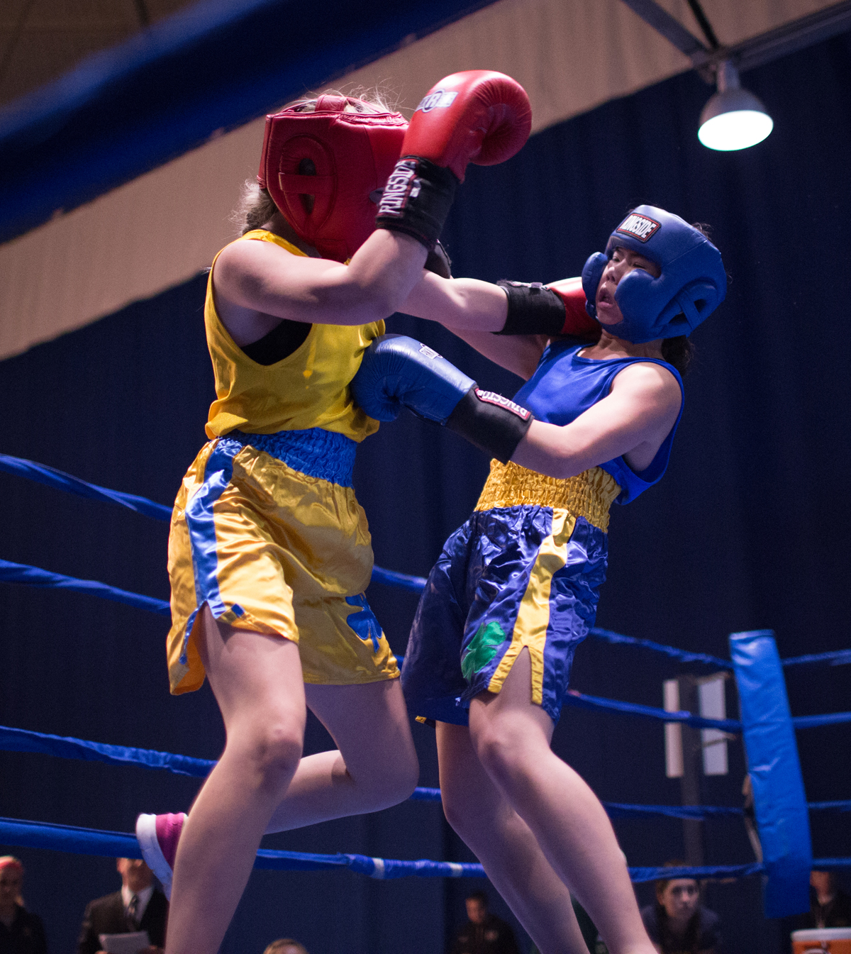 "Senior Amanda ""Boxing Panda"" Leung connects on a jab to the body while absorbing a shot to the side of the head during her semifinal victory over sophomore Mia ""The Hulk"" Hogan-Davis on Tuesday night. Leung won her final against Casey ""C My Fists"" Gelchoin in a split decision Friday night at the Joyce Center Fieldhouse."