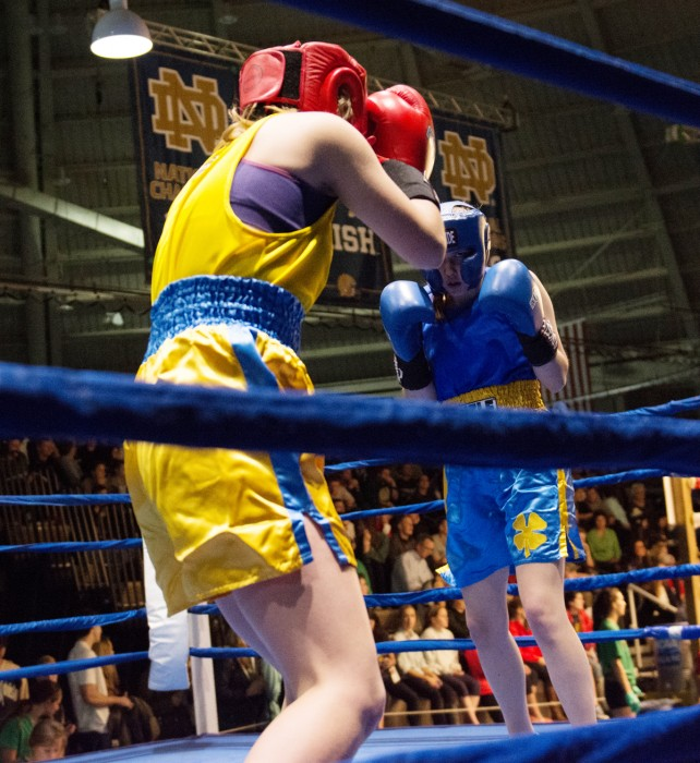 Junior Shannon Bugos, right, stares down sophomore Ellen McCourt during their semifinal bout Tuesday night at Joyce Center Fieldhouse. Bugos won the fight by unanimous decision.