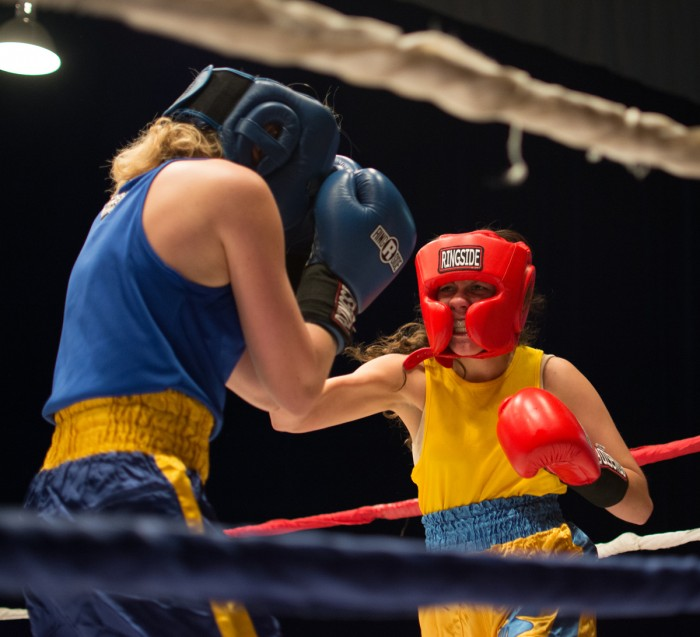 "Senior Val ""Valiswag"" Williams unleashes a hook during her unanimous decision victory over sophomore Mercedes ""Merciless"" De la Rosa in the semifinal round Tuesday night in Joyce Center Fieldhouse."