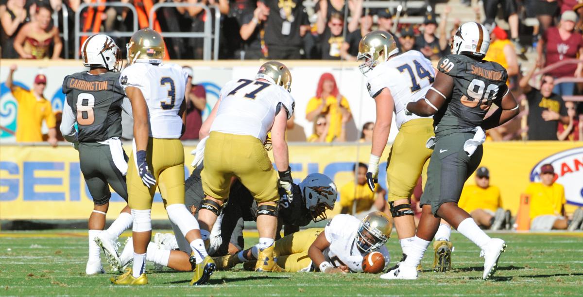 Irish senior quarterback Everett Golson falls to the ground during Notre Dame's 55-31 loss to Arizona State on Saturday at Sun Devil Stadium in Tempe, Arizona.