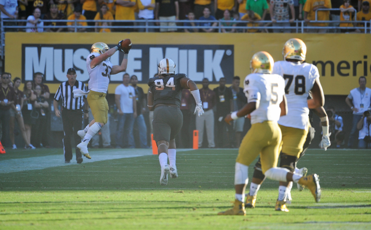 Irish senior running back Cam McDaniel snatches a pass from senior quarterback Everett Golson  during Notre Dame's 55-31 loss to Arizona State on Saturday in Tempe, Arizona.