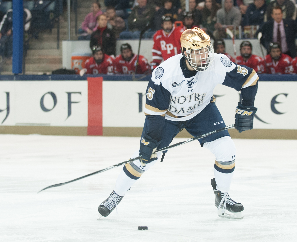 Irish senior defenseman Robbie Russo controls the puck during Notre Dame's 3-2 loss to Rensselaer on Oct. 10.