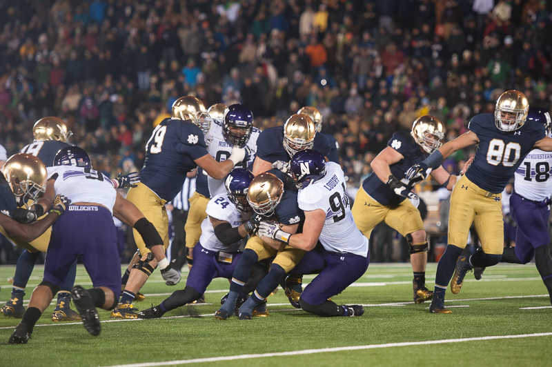 Irish senior running back Cam McDaniel fumbles in the fourth quarter of Northwestern's 43-40  overtime victory over Notre Dame on Saturday at Notre Dame Stadium.