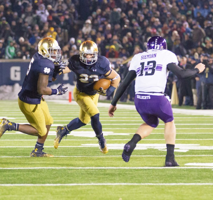 Irish freshman safety Drue Tranquill heads upfield after recovering a fumble Saturday against Northwestern at Notre Dame Stadium.