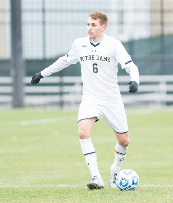 Irish senior defender Max Lachowecki surveys the field while preparing to pass during Notre Dame's 3-0 win over Virginia on Nov. 9.
