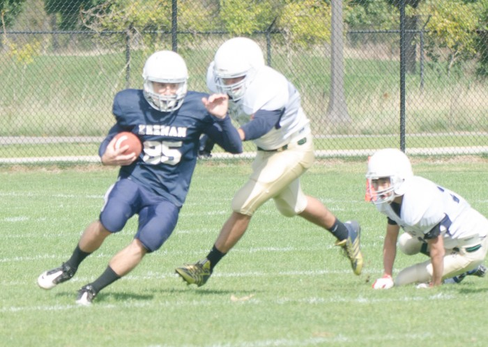 A Keenan running back rushes past O'Neill defenders in a 20-0 win for the Knights on Oct. 5.