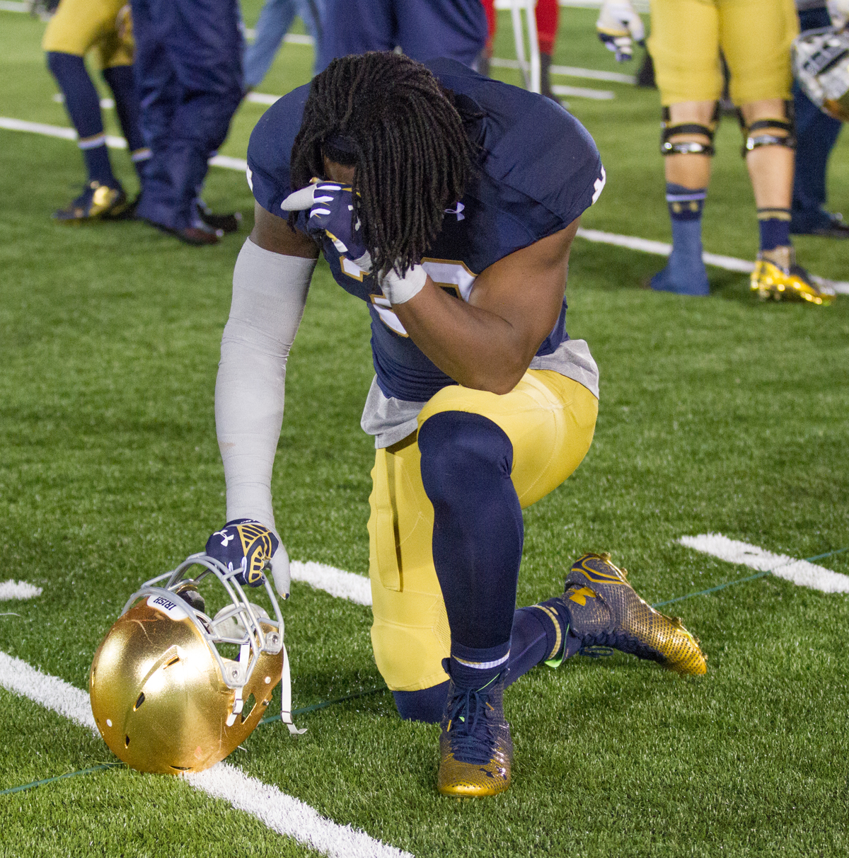 Irish sophomore linebacker Jaylon Smith drops to one knee after Notre Dame's 31-28 loss to Louisville on Saturday at Notre Dame Stadium on Senior Day.