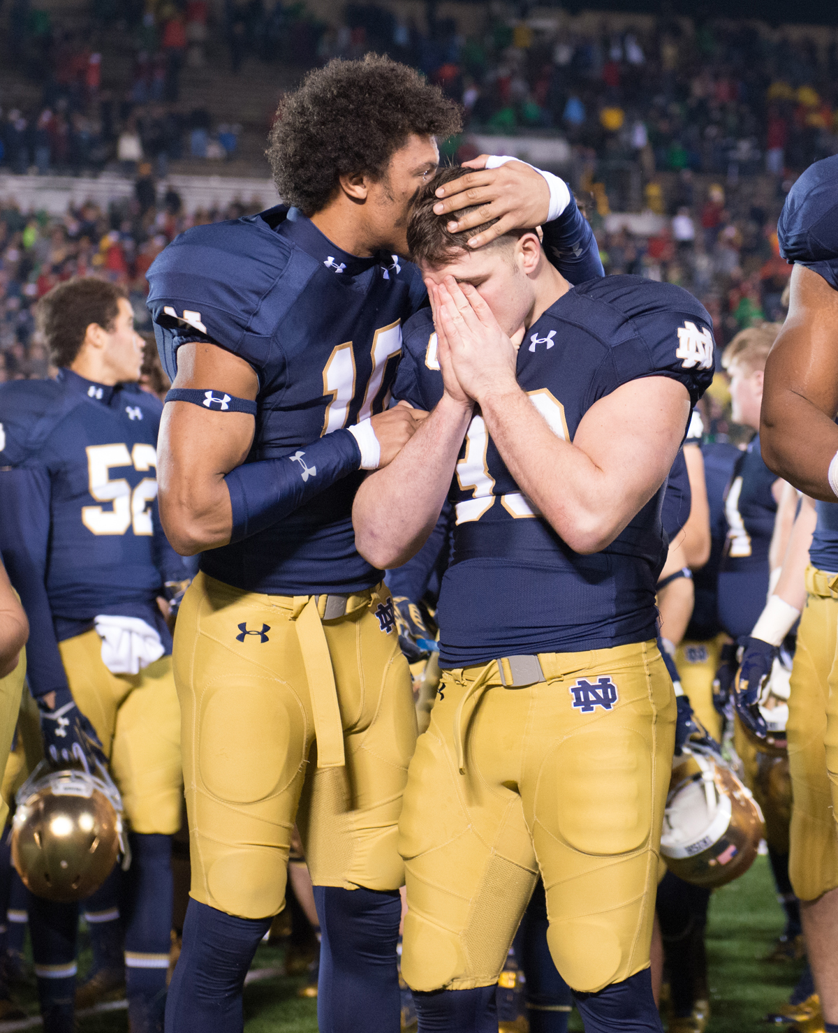 Irish sophomore safety Max Redfield, left, consoles senior running back Cam McDaniel following Notre Dame's 31-28 loss to Louisville on Saturday at Notre Dame Stadium.