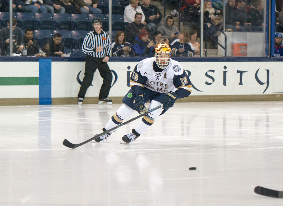 Irish senior right winger Peter Schneider skates after a loose puck during Notre Dame's 2-2 tie with UMass-Lowell on Nov. 21.
