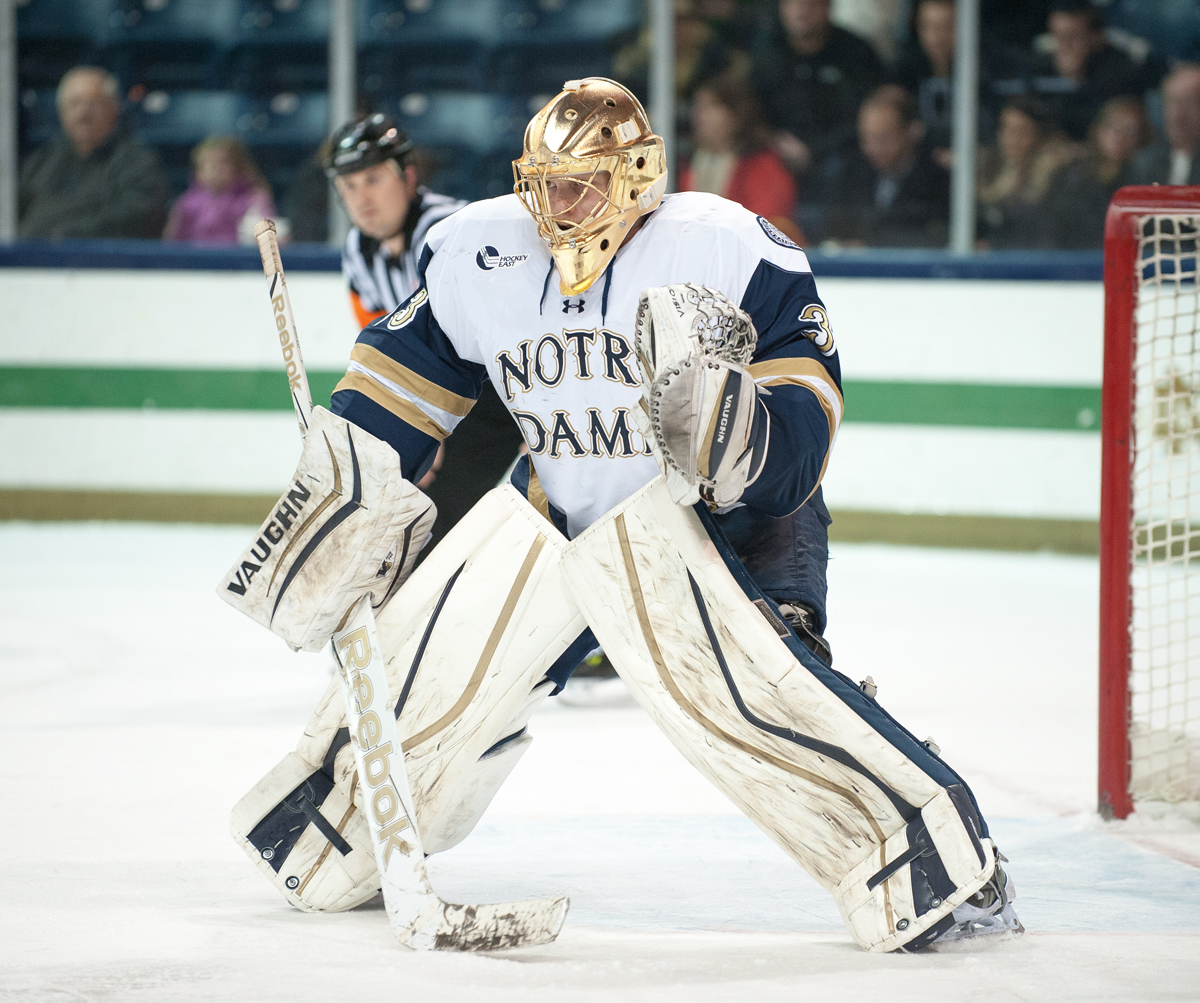 Irish sophomore goalie Chad Katunar waits for the puck to drop against Union at Compton Family Ice Arena on Nov. 28. Notre Dame fell in overtime, 3-2.