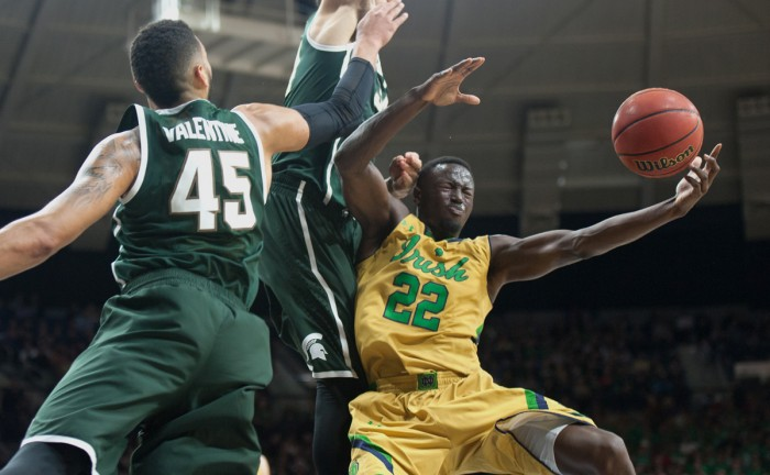 Irish senior guard Jerian Grant battles through traffic during Notre Dame's 79-78 overtime win over No. 19 Michigan State on Wednesday night in Purcell Pavilion. Grant led all scorers with 27 points.